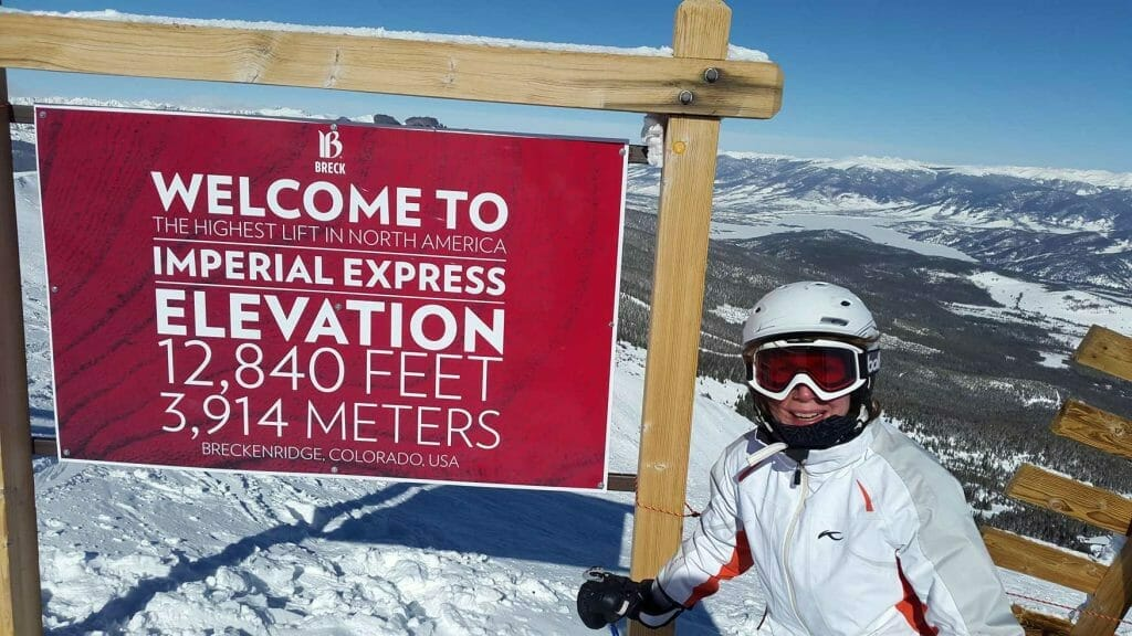 Me standing next to the elevation sign at the top of Imperial
