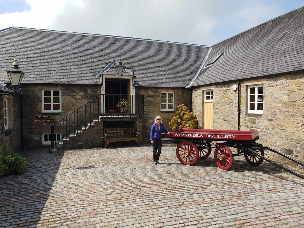 Standing outside the Strathisla Distillery on the whisky trail