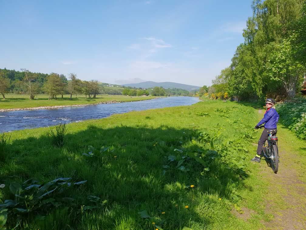 Cycling along by the river