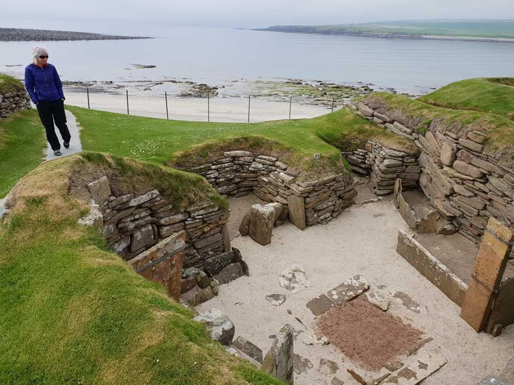 Looking at Skara Brae on Orkney