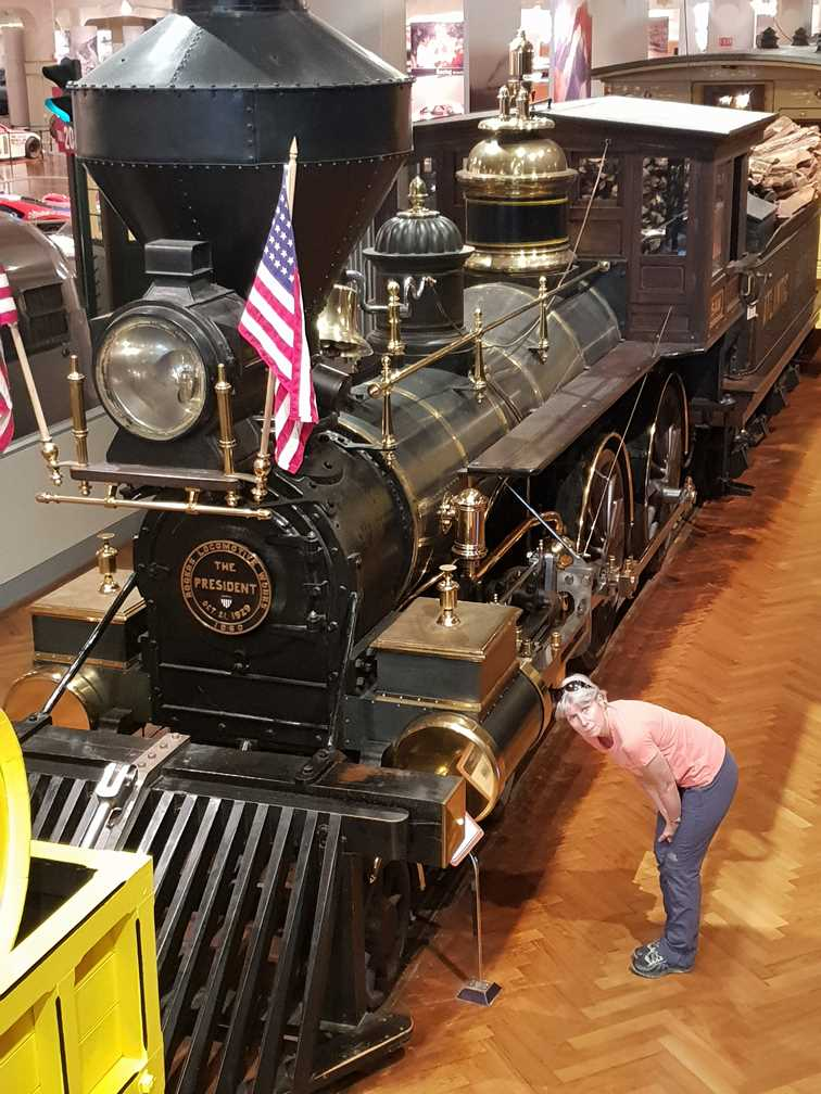 Examining a steam engine in the Henry Ford