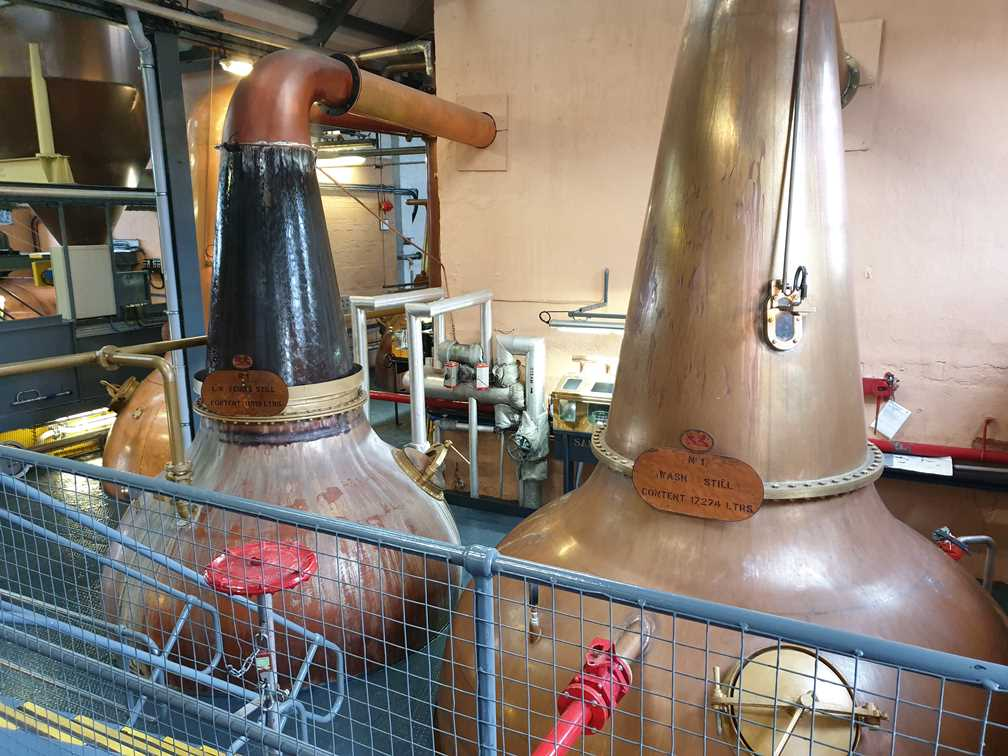 Copper stills with water running over them
