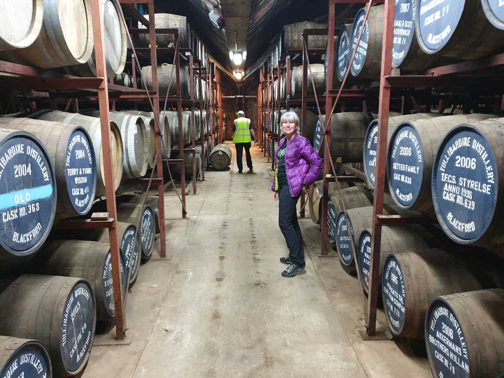 Standing among the barrels in the warehouse