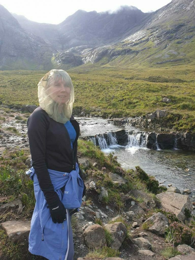 Wearing a midgy net at the Fairy Pools