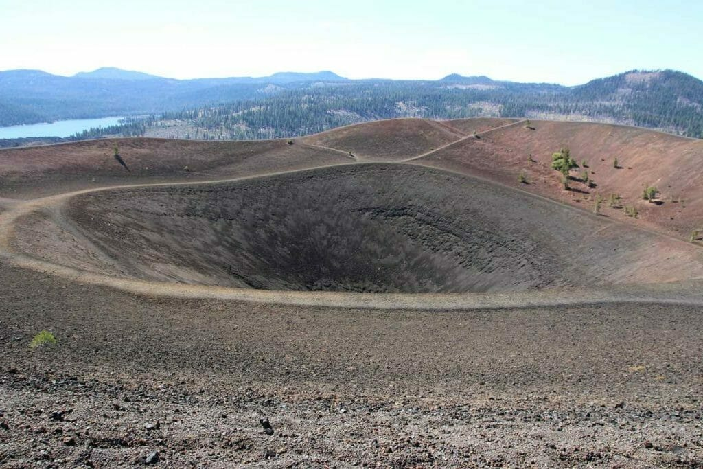 The crater at the top of the cinder cone and the view of the landscape