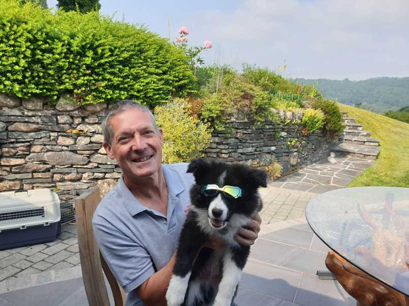 Travelling with a dog wearing doggles