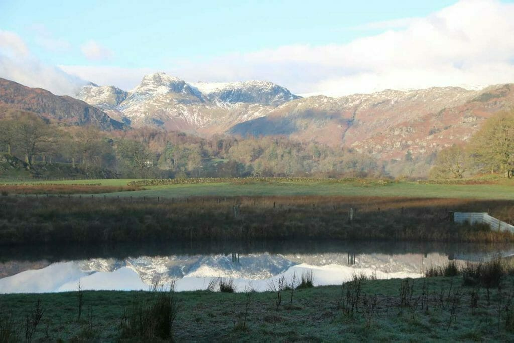 View of the Langdales from Elter Water on a Lake District Walk