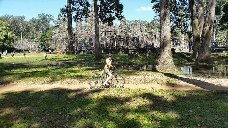 On bike in front of ruined temple