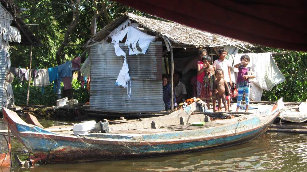 Family living at side of Tonle Sap