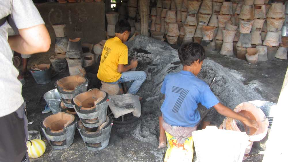 Young boys working in the clay pot factory