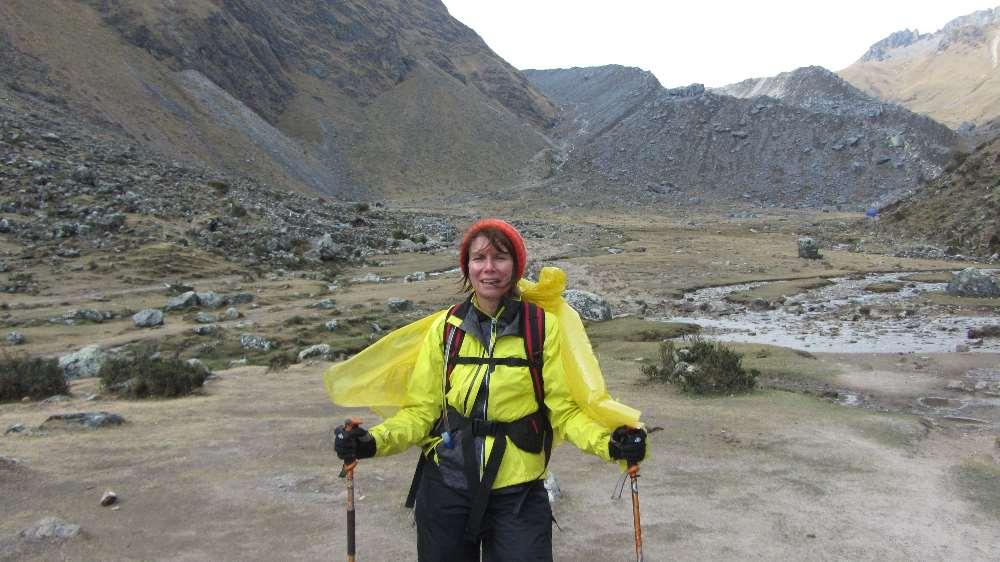 Jane in waterproofs on hiking in Peru Salkantay trek