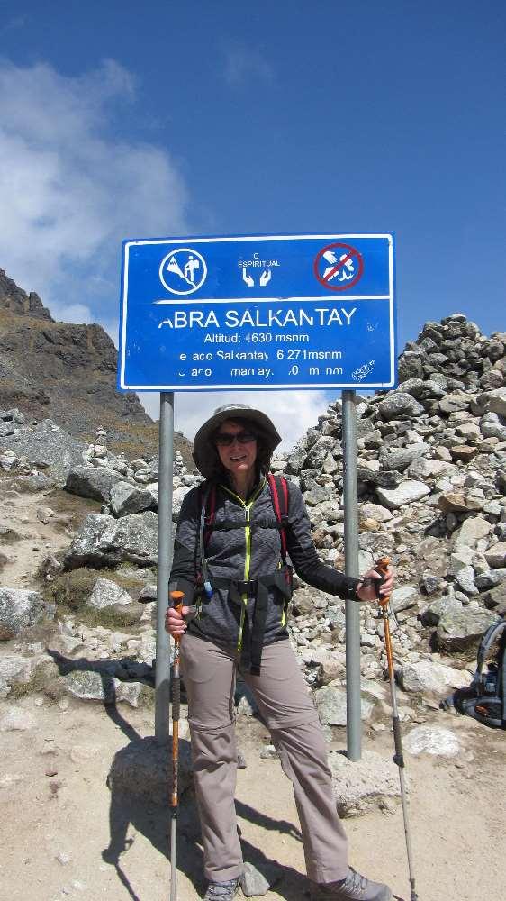 Jane at summit of Salkantay Pass while hiking in Peru