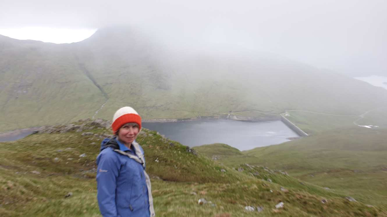 Jane with Ben Cruachan in fog in background