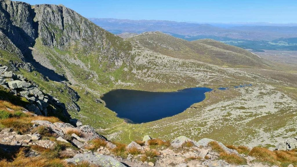View on Lochnagar over tarn on possibly the best hike in Scotland